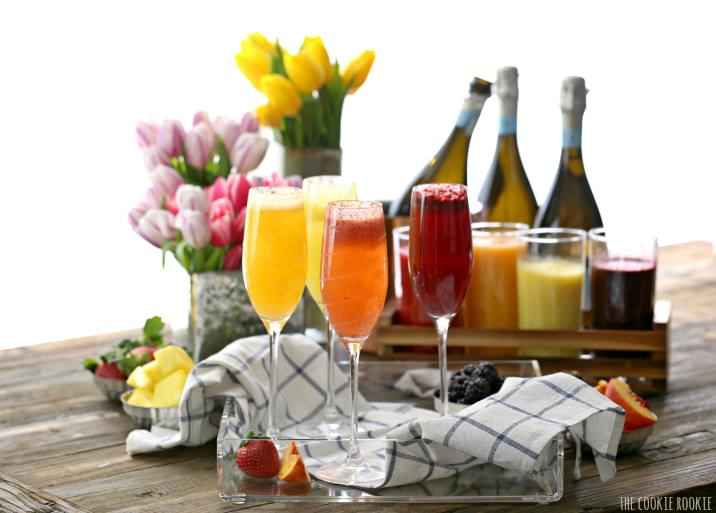 Homemade Bellini Bar made easy with fruit purees and Prosecco! You can use sparkling water for a tasty non-alcoholic brunch or breakfast. So fun and tasty! | The Cookie Rookie