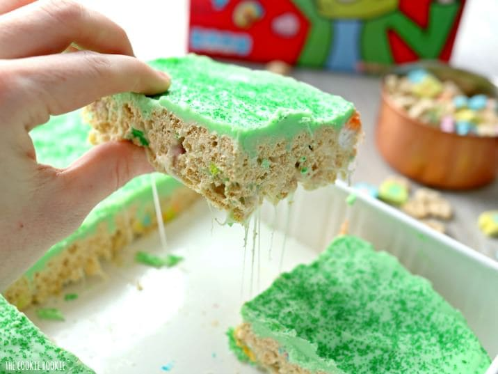 Iced Lucky Charms treats, perfect for St. Patrick's Day! Fun desserts topped with a green almond bark icing. Delicious and easy, made in minutes!   The Cookie Rookie