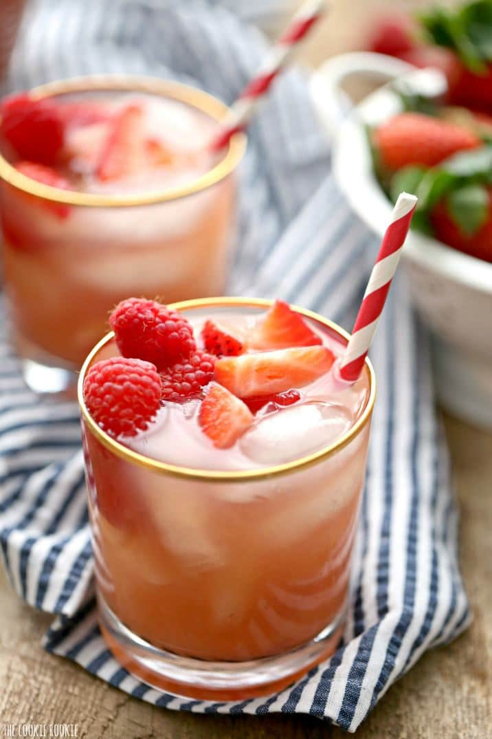 Easy Red Berry Sangria made with Pearl Red Berry Vodka, Moscato white wine, berry juice, and soda! Refreshing strawberry and raspberry sangria. YUM!