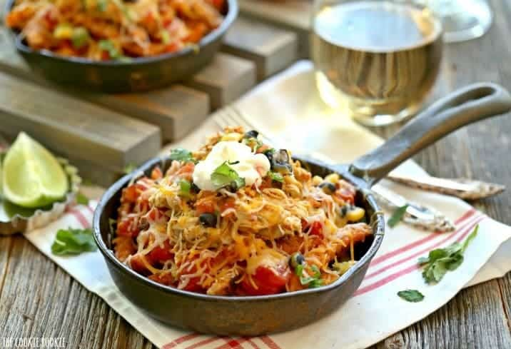 Skinny Loaded Sweet Potato Fry Nachos! Simple Skillet Nachos made with sweet potato fries and loaded with healthy toppings! | The Cookie Rookie