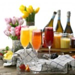 several homemade bellinis in champagne glasses