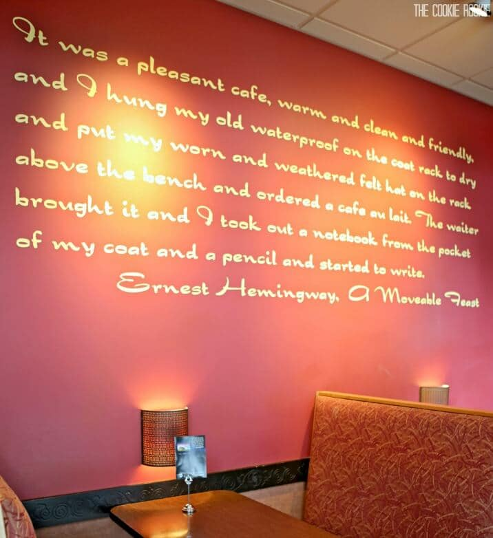 Ernest Hemingway quote on red wall