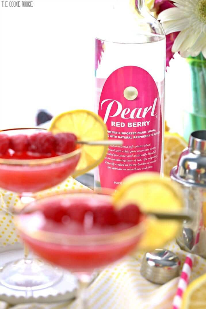 martinis in front of a bottle of pearl red berry vodka