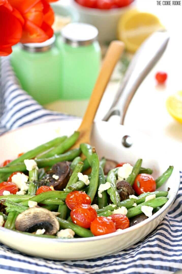 Roasted Green Beans with Feta and Tomatoes is bright, delicious, and healthy! The perfect easy side dish for any dinner. Made quickly and simply!