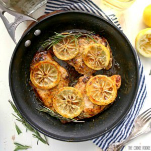 chicken breasts with lemon slices in a skillet
