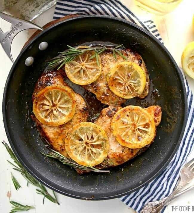 Chicken in skillet with sliced lemons
