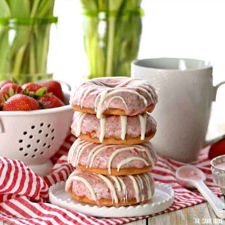 Strawberries and Cream Cake Mix Donuts are the perfect easy breakfast, baked and not fried! Thrown together in minutes and delicious for the entire family!