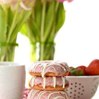 strawberries and cream donuts on a plate