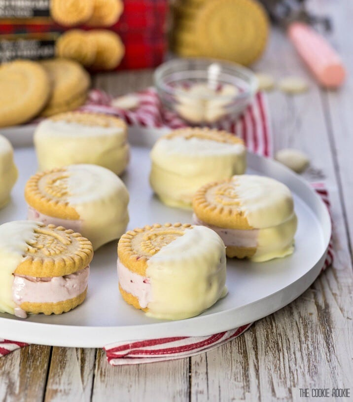 Strawberry Shortcake Ice Cream Sandwiches, such a fun and sweet dessert for any occasion! Shortbread cookies stuffed with strawberry ice cream and dipped in white chocolate! Perfection!