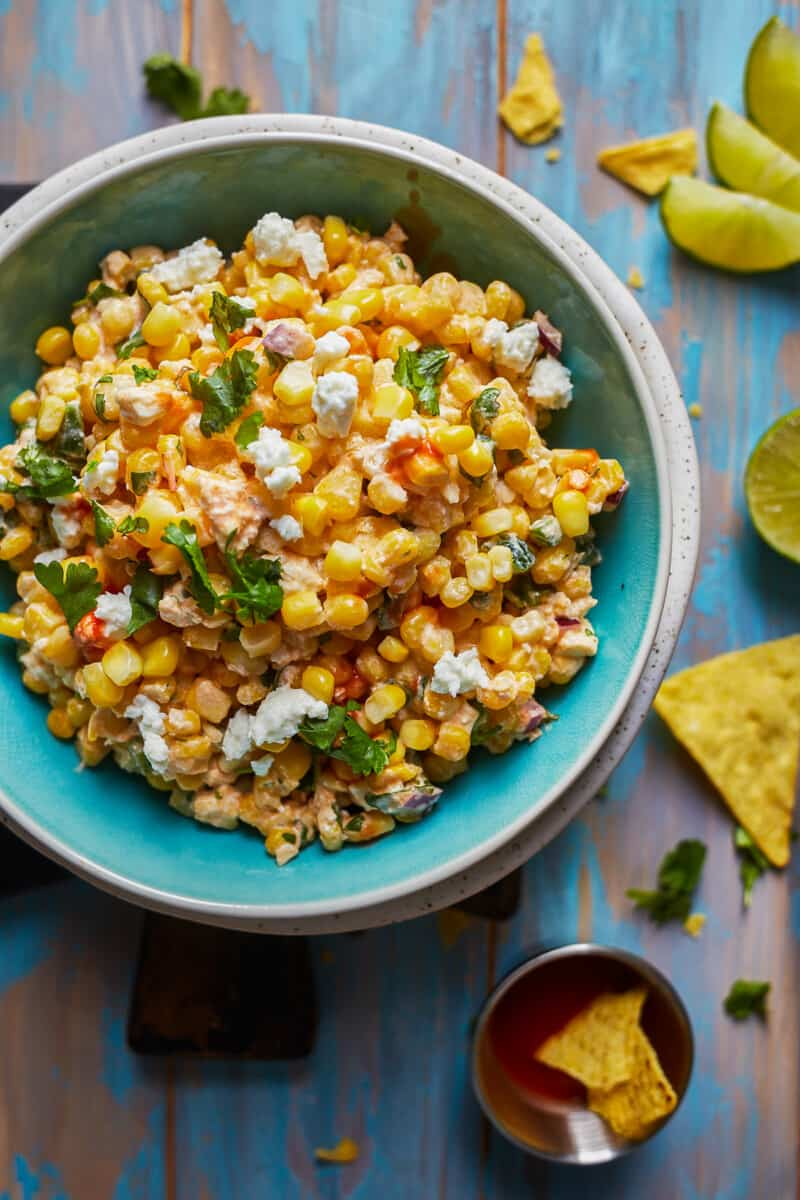 green bowl filled with healthy Mexican street corn dip