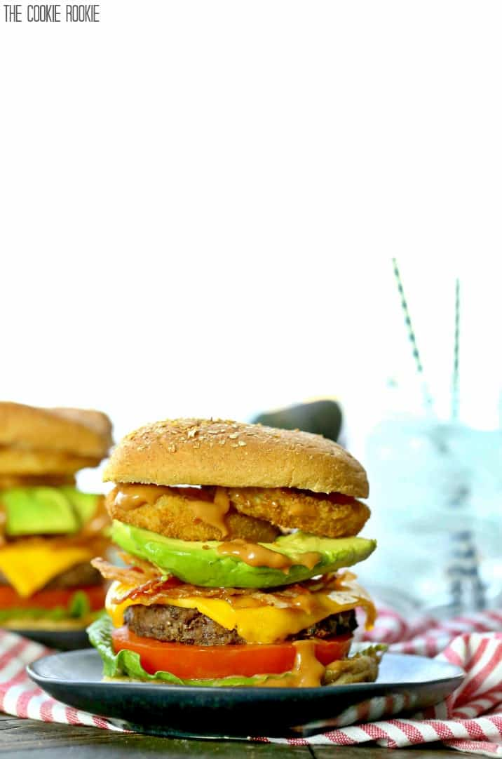 grilled BBQ burgers with onion rings and bacon