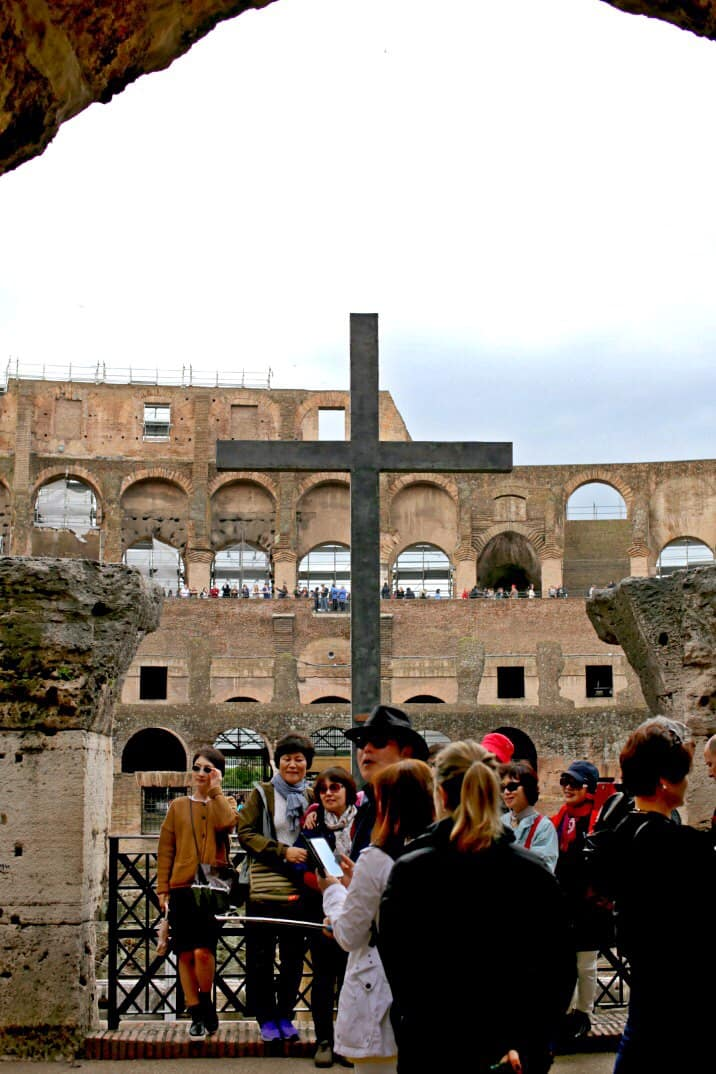 cross in front of large old building in rome