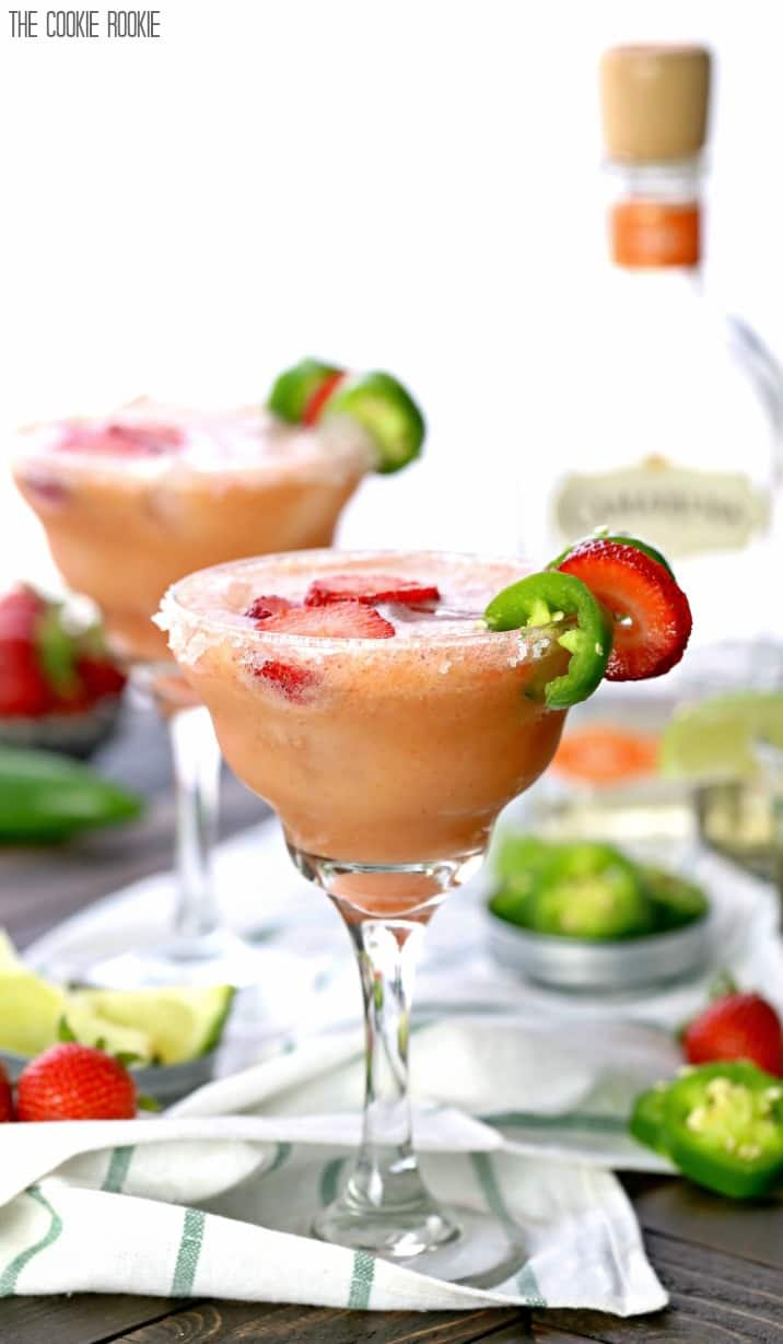Skinny Strawberry Jalapeno Margarita made healthier with fruit juices and agave nectar! These are easy and SO ADDICTING! Cheers on Cinco De Mayo!