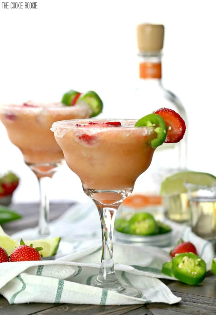Skinny Strawberry Jalapeno Margaritas made healthier with fruit juices and agave nectar! These are easy and SO ADDICTING! Cheers on Cinco De Mayo!