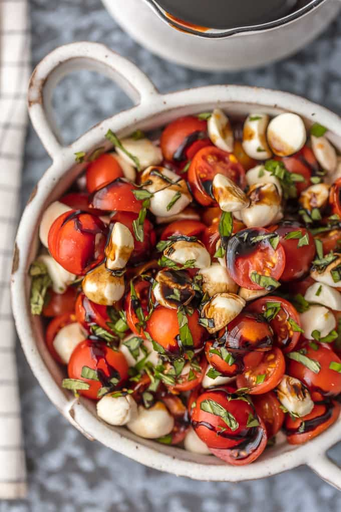 up close picture of caprese salad in a bowl