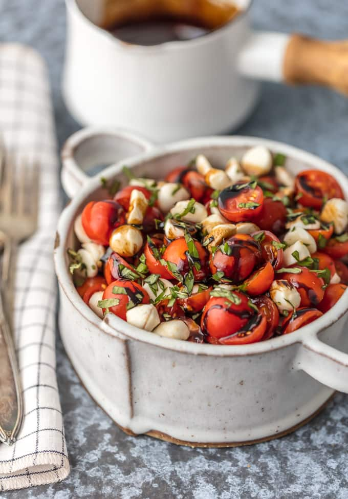 chopped caprese salad with basil, balsamic, tomato, and mozzarella