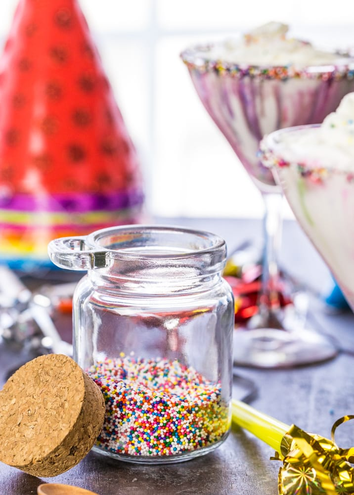 Funfetti Cake Batter Martinis! Don't let the kids have all the fun at your next birthday party! These delicious martinis steal the show and taste just like funfetti cake!