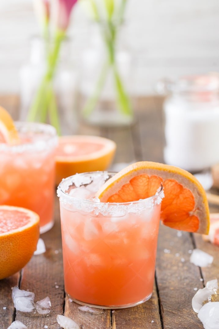 cocktail garnished with salted rim and slice of grapefruit
