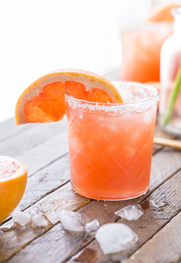 close up of grapefruit salty dog on a table with ice