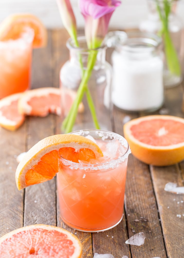 cocktail with grapefruit slices around it
