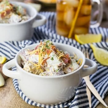 Loaded Baked Potato Salad, the perfect BBQ side dish! Loaded with everything that's good, sour cream, cheese, bacon, chives, THE BEST POTATO SALAD!