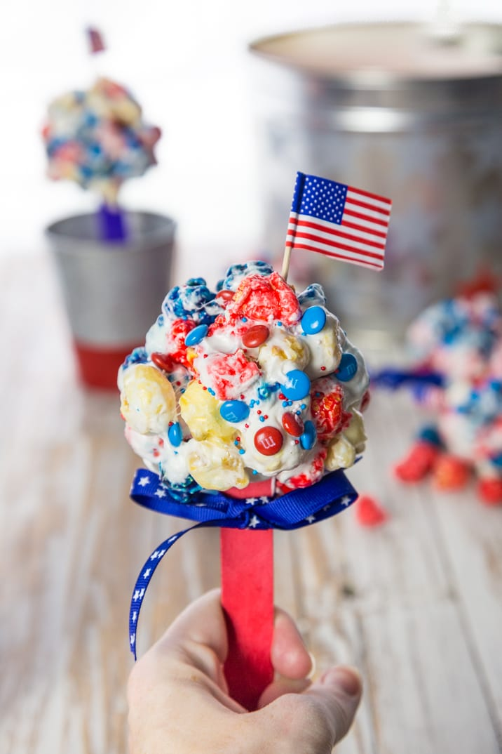 Patriotic Popcorn Pops, a super fun and cute red white and blue popcorn lollipop perfect for Memorial Day and the Fourth of July!