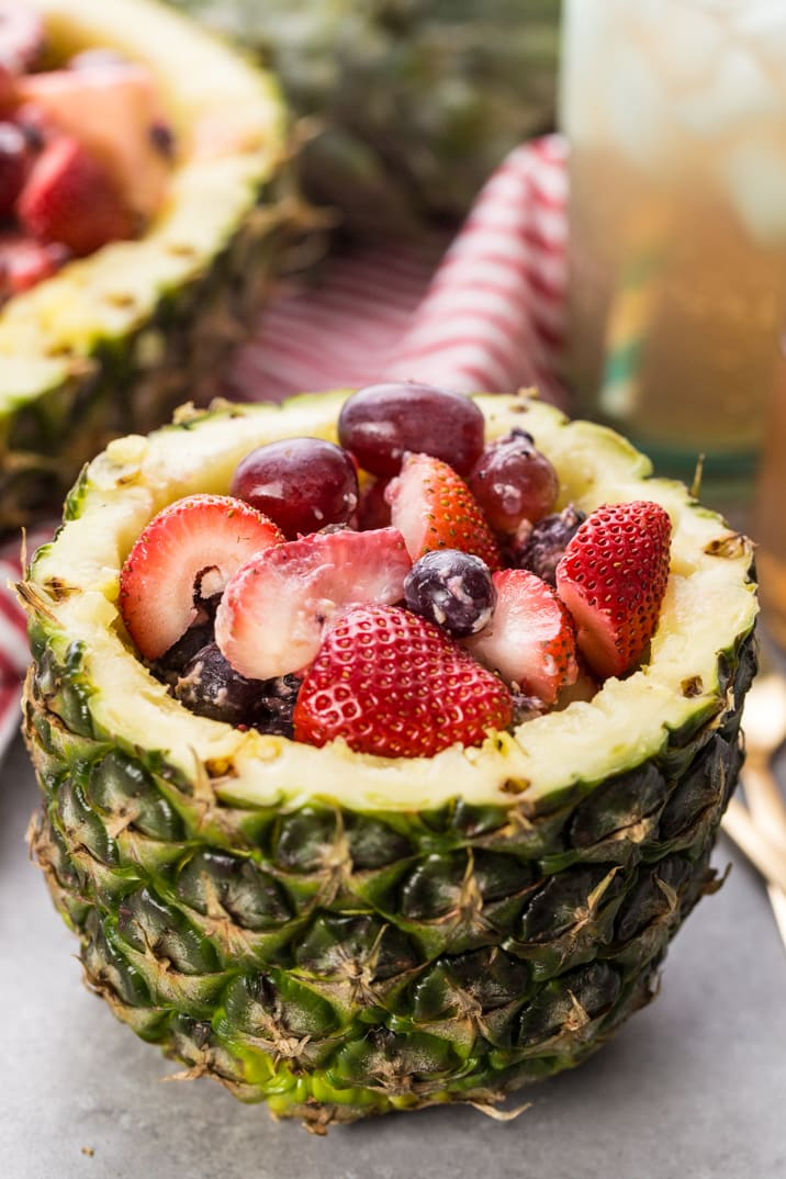 Super Easy Fruit Salad in Pineapple Bowls! Nothing screams Summer more than fruit salad served in a pineapple bowl or boat! So fun, tasty, and EASY!