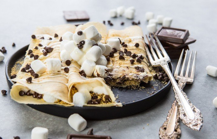 Loaded S'more Crepes! It doesn't get better than Smore Crepes, packed with toasted marshmallows, graham cracker crumbs, and lots of milk chocolate!