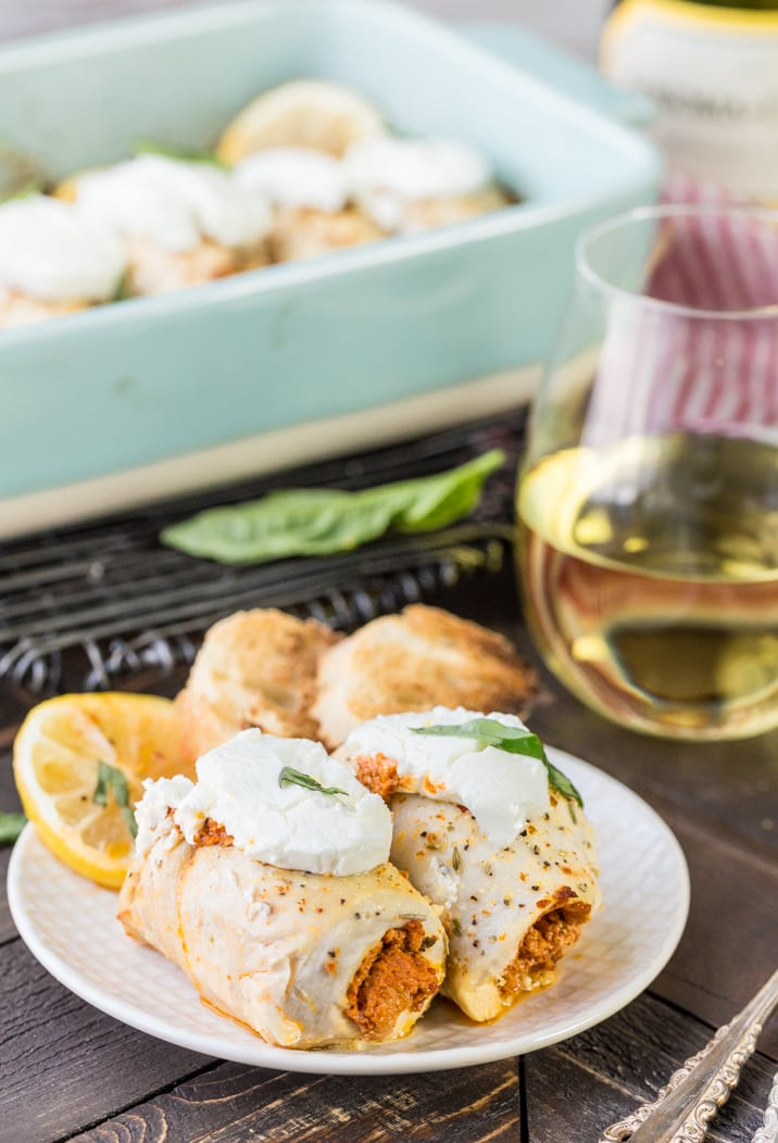 Stuffed Chicken Bryan Rollups! This variation on our favorite Carrabba's recipe is a favorite at our house! Chicken stuffed with a sun dried tomato and goat cheese mixture and then topped with lemon butter sauce and fresh basil! TO DIE FOR!