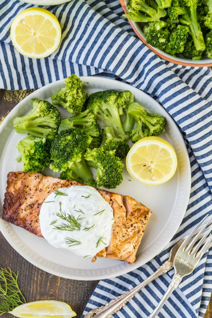baked salmon fillet on a plate with broccoli