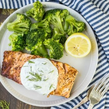 Baked Salmon Fillet with Greek Yogurt Ranch is a healthy, easy, and DELICIOUS dinner that anyone can make in minutes. This simple baked salmon recipe is one of our absolute favorite summer meals! Flavorful oven baked salmon fillet with the creamiest topping.