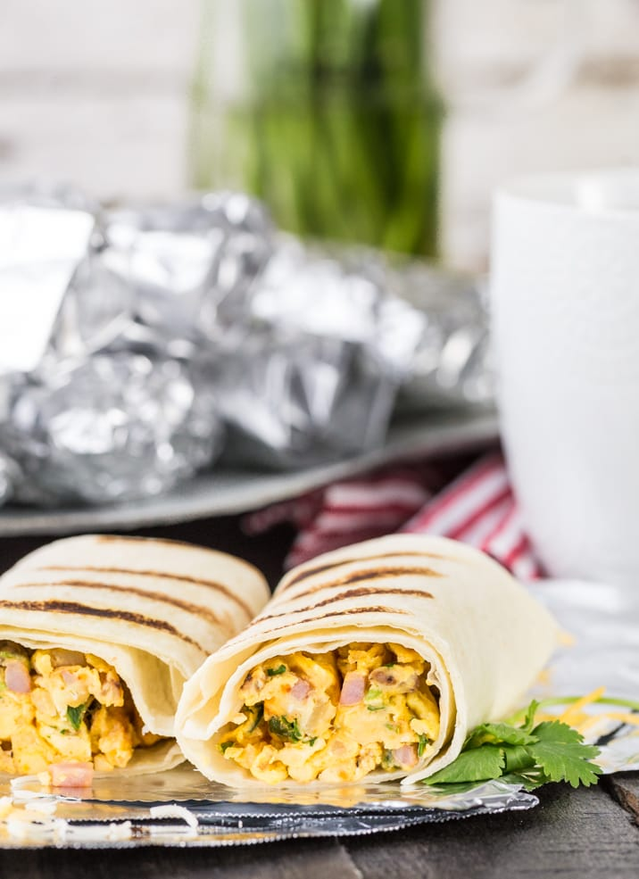 Southwest Make Ahead Breakfast Burritos couldn't be easier or more delicious! These easy make ahead breakfast burritos are the perfect meal to take camping or freeze for busy mornings before school!