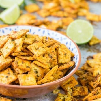 Mexican Spice Cheese Crackers, perfect for any party of for tailgating! Made with cheese-its, taco seasoning, and cilantro! SO ADDICTING!
