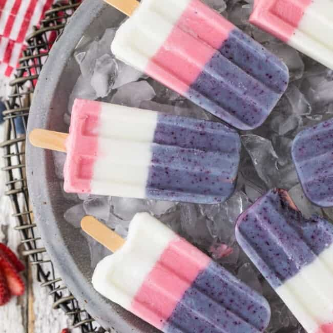 Red White and Blue Smoothie Pops on a bed of ice