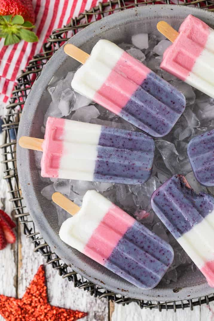 Red White and Blue homemade popsicles on a tray of ice
