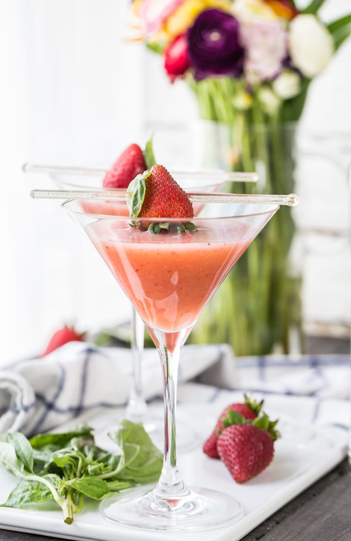 We LOVE these Strawberry Fields Martinis featuring Strawberry Basil Vodka! The herbs and fruit are so delicious; the perfect Summer cocktail!