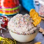funfetti cake batter dip with pretzels in a bowl