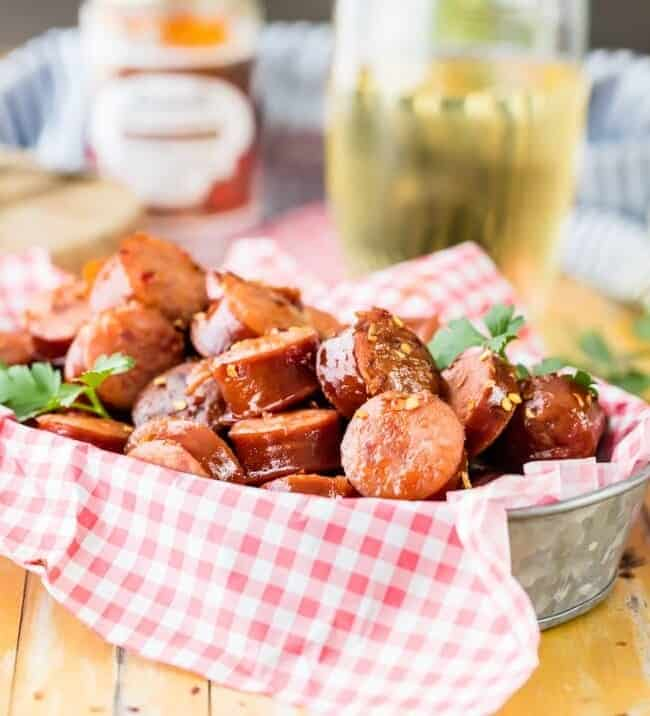 Crock Pot Kielbasa Sausage Bites are a tailgating favorite! This sweet and spicy kielbasa appetizer is SO EASY to make. There's nothing better than a slow cooker kielbasa recipe to make an easy game day appetizer. They are so addicting!
