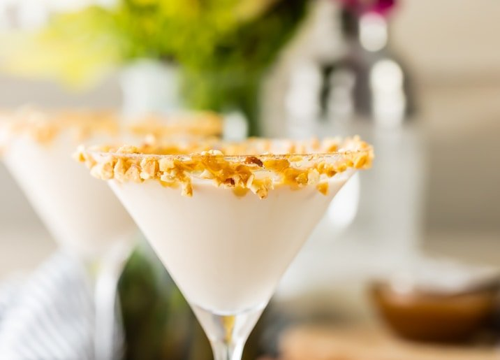 close up view of martini with crushed peanuts on the rim