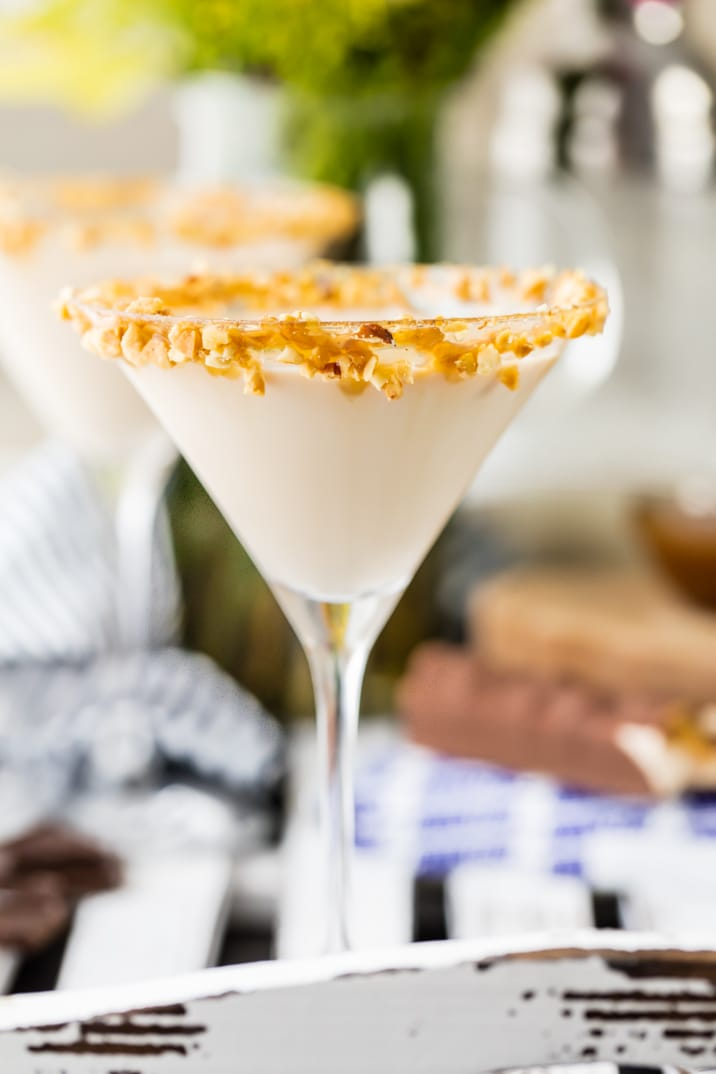 creamy martini glass on a tray