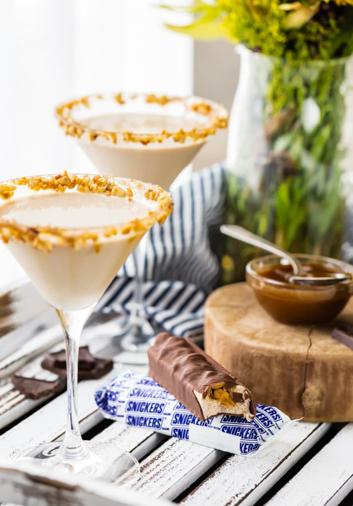 a martini next to snickers ice cream bars