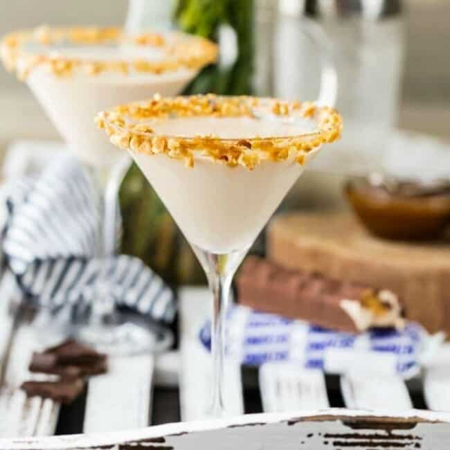 two martini glasses rimmed with crushed nuts