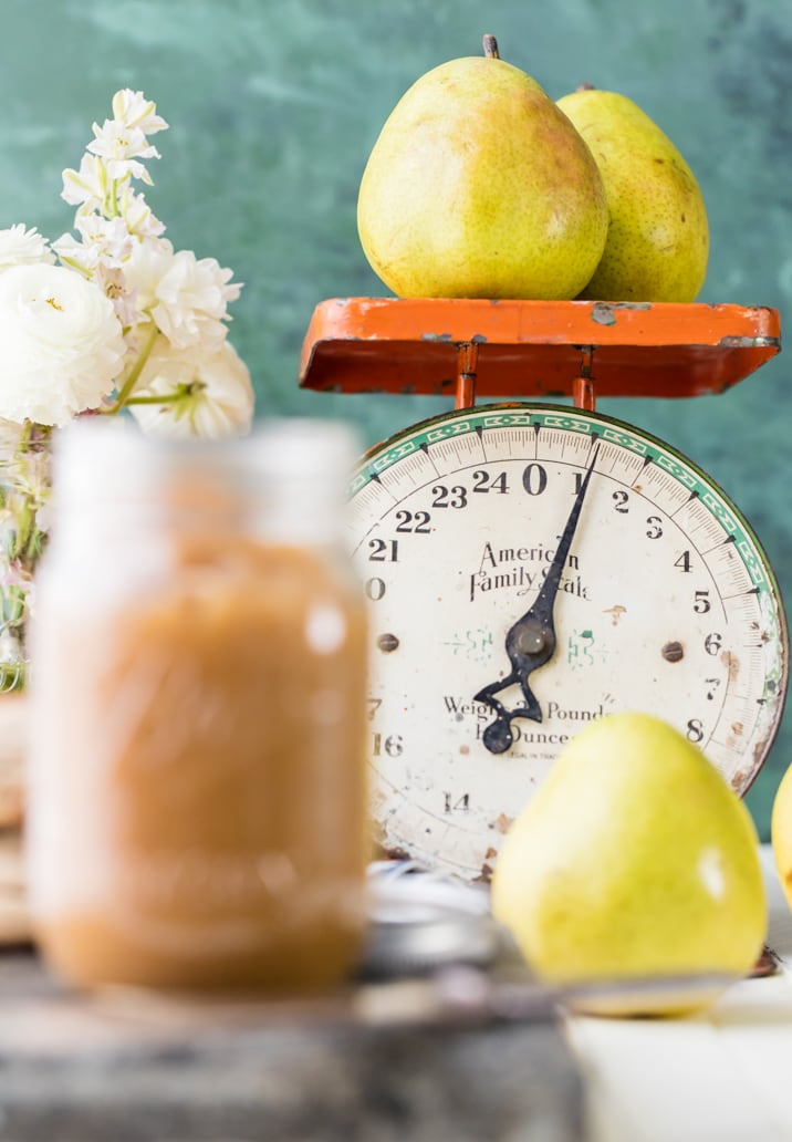 pear butter next to a scale weighing pears