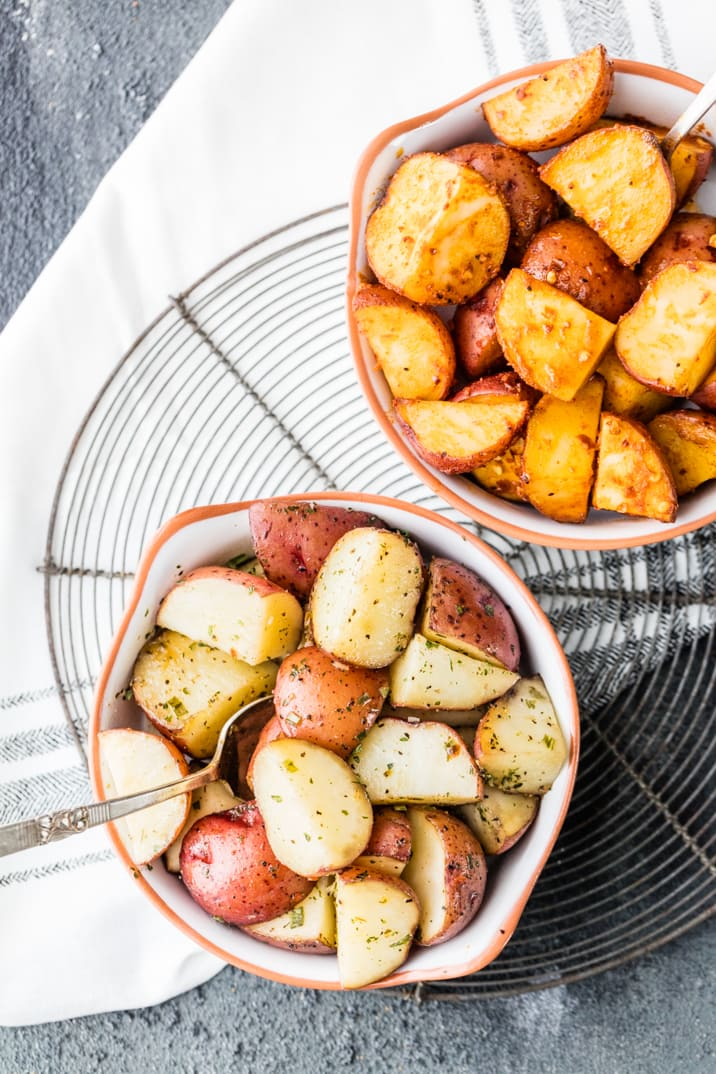 Crock Pot Potatoes are our favorite easy side dish recipe! We have made these Slow Cooker Potatoes two ways, in Garlic Ranch and Taco flavored! My mind is blown by how simple making Crockpot Red Potatoes can be...and the sky is the limit with flavors. This recipe is amazing as a side dish to almost any meal...such a great weeknight option.