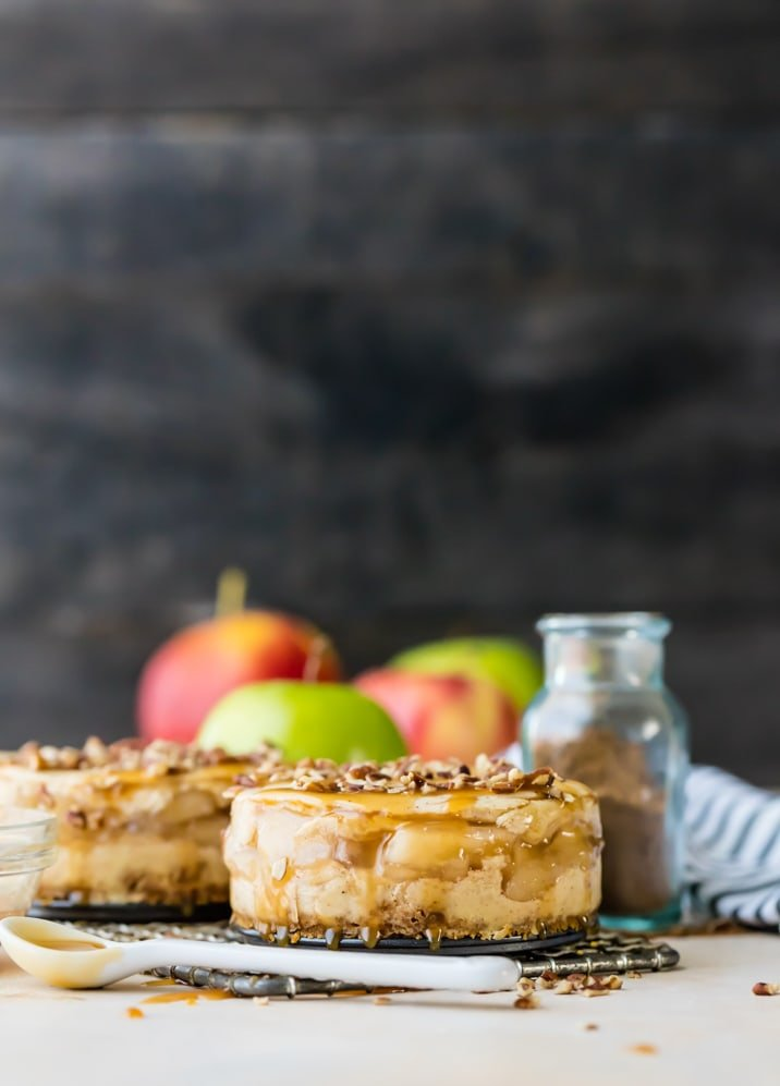 FALL BAKING IS HERE! Start the season with these simple and divine Mini Apple Pie Cheesecakes! You can't mess these up! Apple Pie sandwiched between two layers of perfect cheesecake!