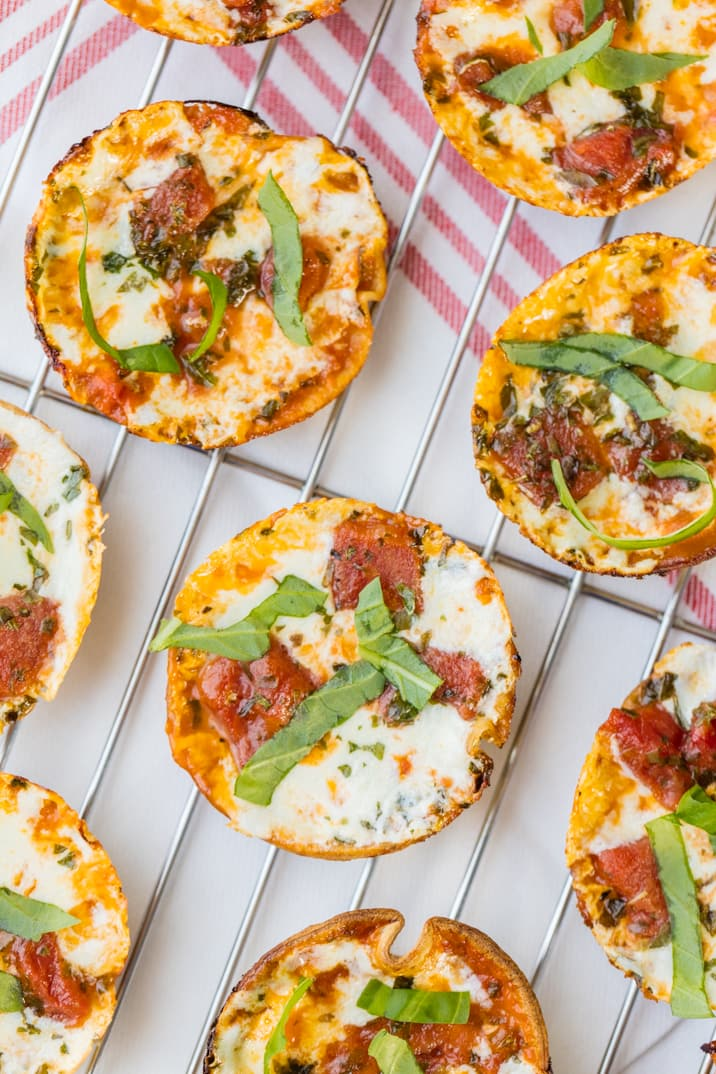 Mini Margherita Pizzas are THE BEST tailgate recipe! Delicious, easy, amazing appetizer perfect for any party or tailgate! YUM!