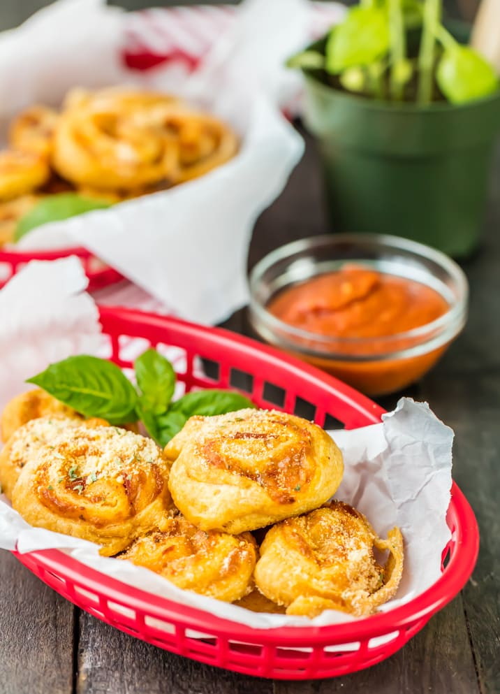 Stuffed Pepperoni Pizza Rolls! Tailgating doesn't get better (OR EASIER) than these cheesy and delicious Pepperoni Pizza Rolls from The Cookie Rookie!