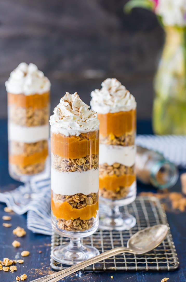 Cheesecake & Pumpkin Pie Parfaits! The perfect healthy(er) alternative to our favorite Thanksgiving pie! Loaded with cinnamon granola, no bake cheesecake, and pumpkin pie!