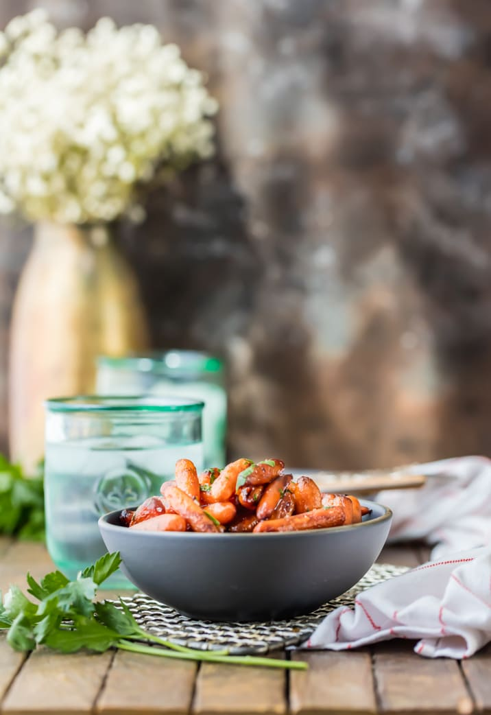 Honey Balsamic Roasted Carrots on a table with glasses of iced water