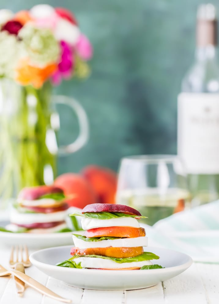 Peach Caprese Stacks with Honey Bourbon Balsamic Reduction. This is my FAVORITE healthy breakfast, brunch, lunch, or dinner! Holding onto Summer as long as possible with this salad!